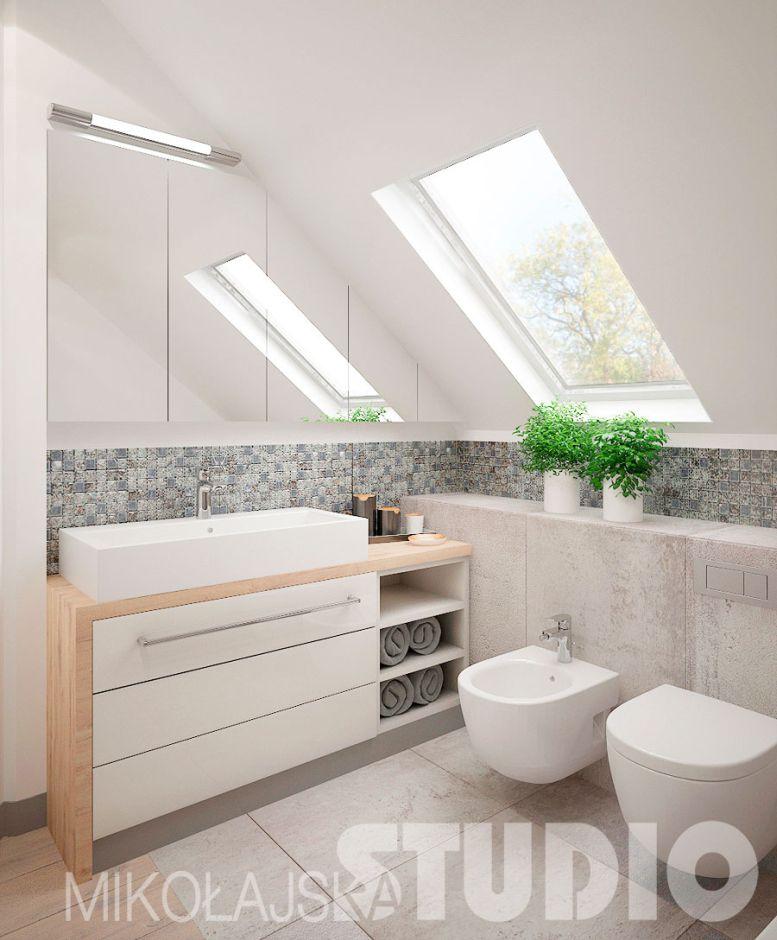Duża prostokątna umywalka w łazience na poddaszu