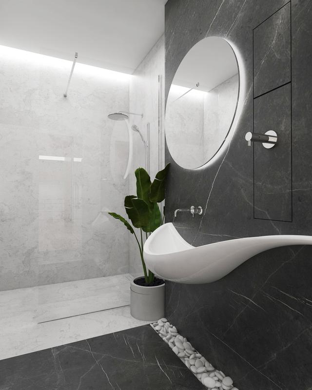 Okrągłe lustro z podświetleniem w łazience z fantazyjną umywalką