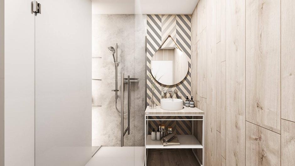 Okrągłe lustro na pasku w beżowej łazience