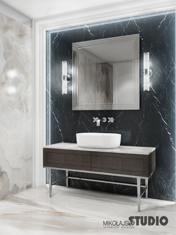 Lustro w eleganckiej łazience z ciemnym marmurem