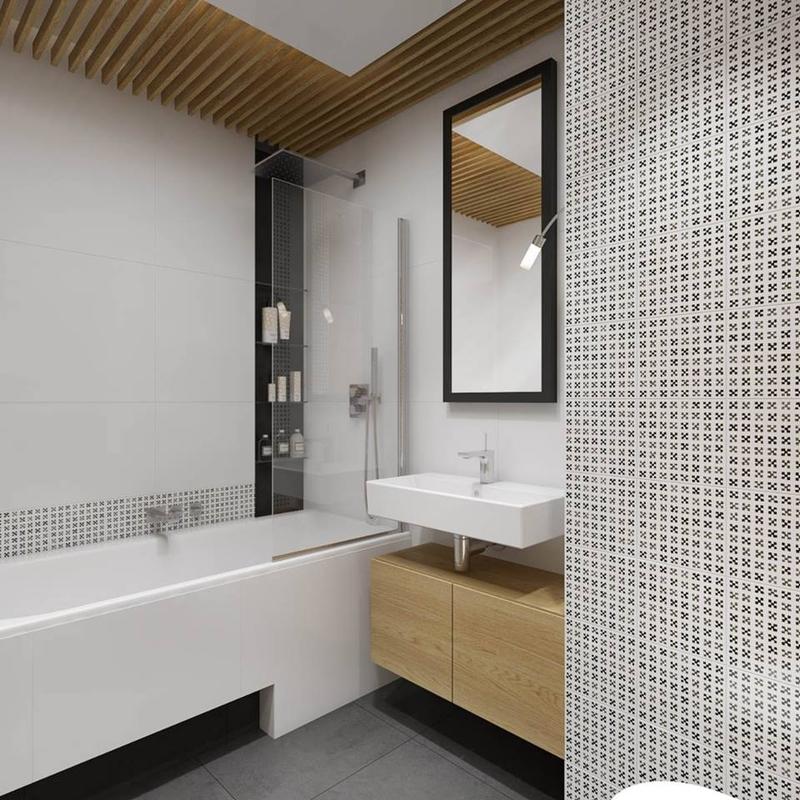 Lustro w czarnej ramie w łazience z wanną wolnostojącą