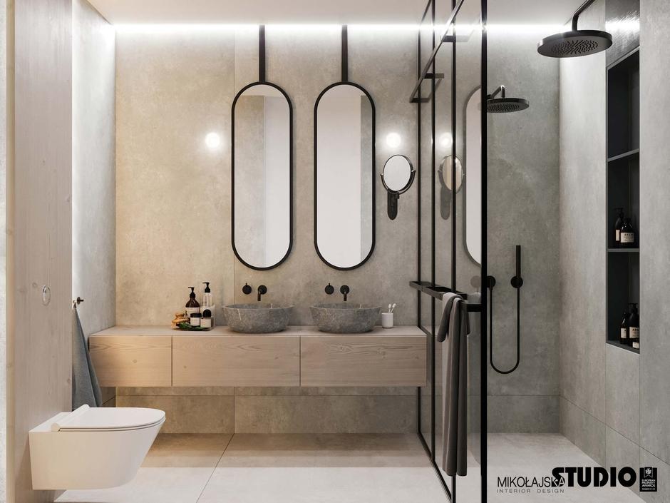 Łazienka w stylu industrialnym z dwoma owalnymi lustrami