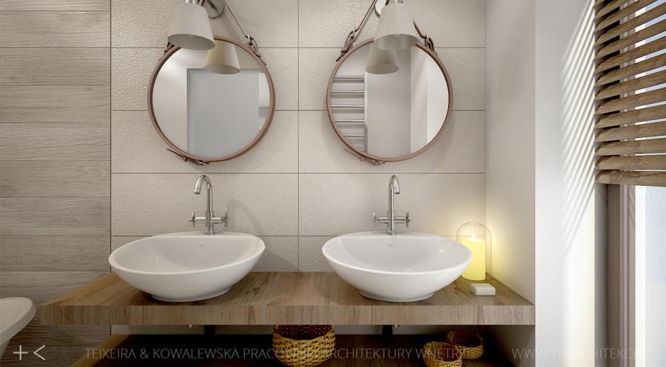 Dwa okrągłe lustra na pasku w aranżacji łazienki