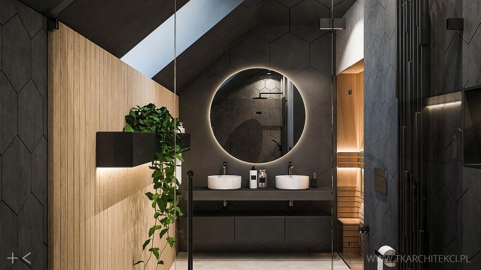 Duże okrągłe lustro z podświetleniem w łazience na poddaszu