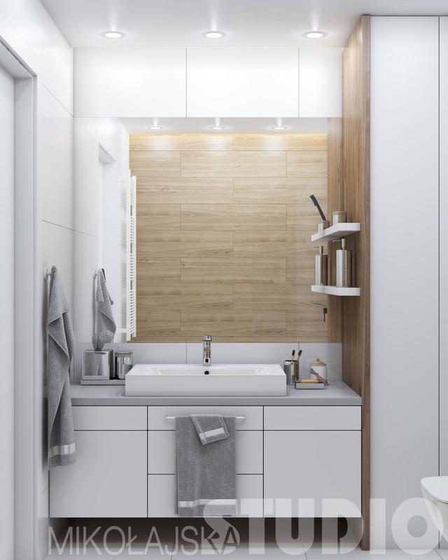 Duże lustro w łazience z drewnem