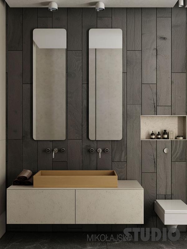 Ciemna łazienka z dwoma lustrami