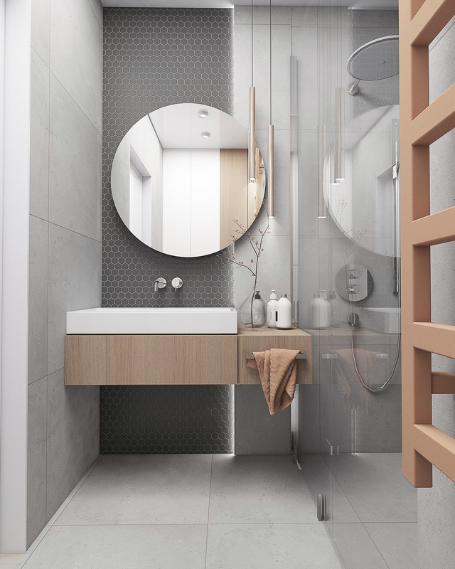 Okrągłe lustro w łazience z heksagonami na ścianie