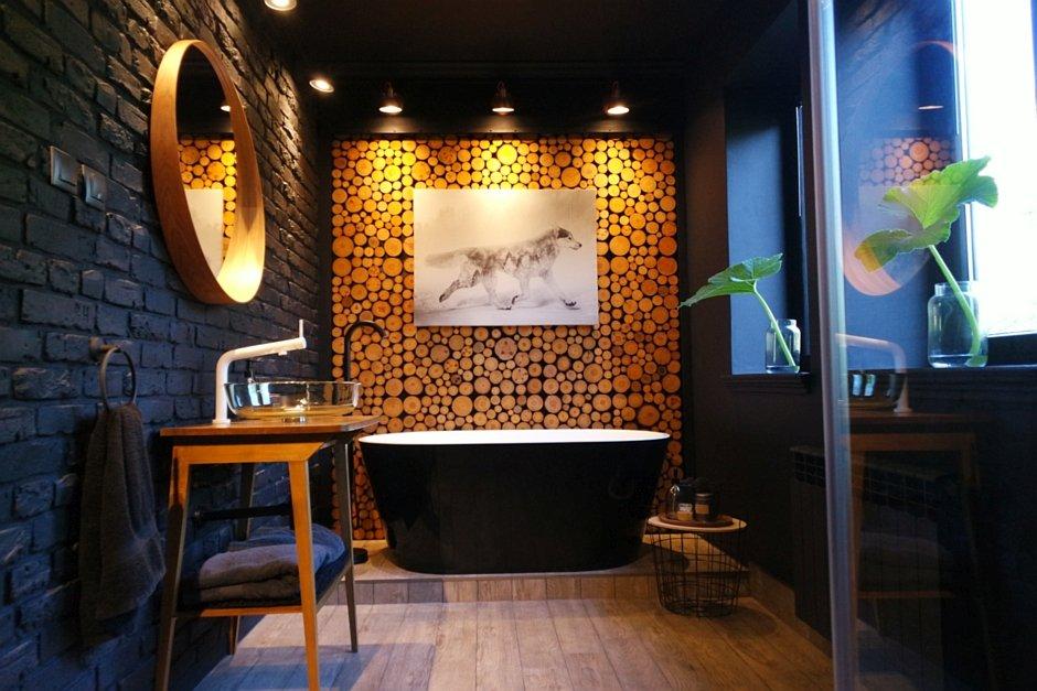 Aranżacja ciemnej łazienki z czarną wanną wolnostojącą