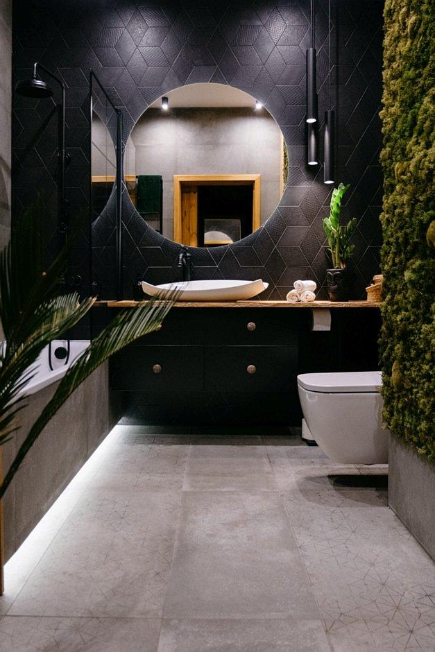 Ciemna łazienka z mchem na ścianie