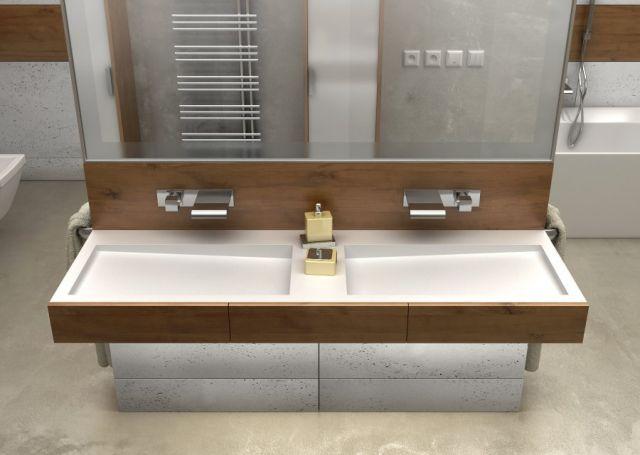 aranżacja nowoczesnej łazienki z umywalką podwójną z odpływem liniowym, z użyciem drewna i okładzinami ściennymi z betonu architektonicznego