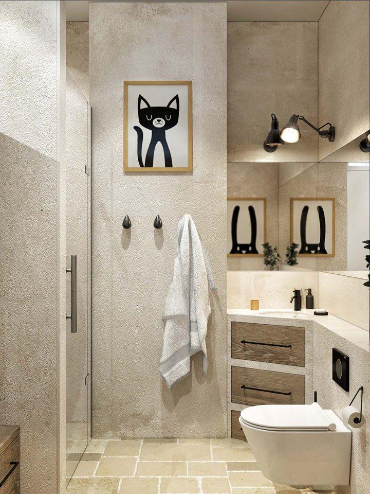 Łazienka z grafikami na ścianie